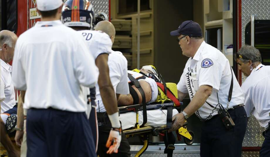 Injured Denver Broncos defensive end Derek Wolfe is carried  to an ambulance after he was hurt on a play in the first half of a preseason NFL football game against the Seattle Seahawks, Saturday, Aug. 17, 2013, in Seattle. (AP Photo/Elaine Thompson) Photo: AP