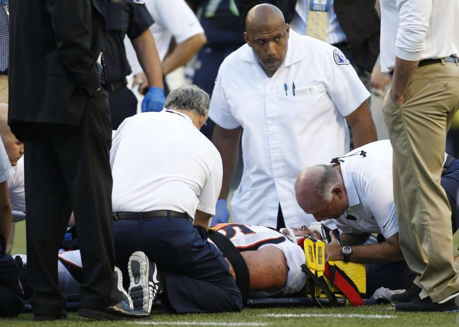 Medical and team personnel attend to Denver Broncos defensive end Derek Wolfe after he was injured on a play in the first half of a preseason NFL football game against the Seattle Seahawks, Saturday, Aug. 17, 2013, in Seattle. (AP Photo/John Froschauer) Photo: AP