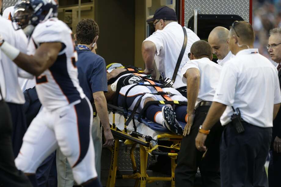 Denver Broncos defensive end Derek Wolfe is carried to an ambulance after he was injured on a play in the first half of a preseason NFL football game against the Seattle Seahawks, Saturday, Aug. 17, 2013, in Seattle. (AP Photo/Elaine Thompson) Photo: AP