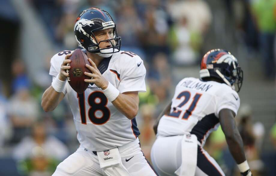 Denver Broncos quarterback Peyton Manning (18) drops back to pass in the first half of a preseason NFL football game against the Seattle Seahawks, Saturday, Aug. 17, 2013, in Seattle. (AP Photo/John Froschauer) Photo: AP