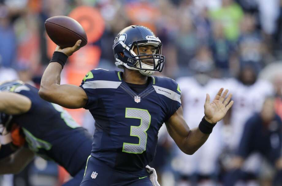 Seattle Seahawks quarterback Russell Wilson passes in the first half of a preseason NFL football game against the Denver Broncos, Saturday, Aug. 17, 2013, in Seattle. (AP Photo/Elaine Thompson) Photo: AP