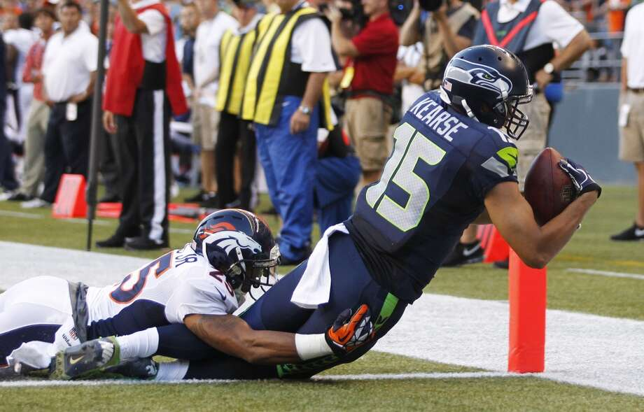 Seattle Seahawks' Jermaine Kearse (15) scores a touchdown as Denver Broncos' Chris Harris tackles him in the first half of a preseason NFL football game, Saturday, Aug. 17, 2013, in Seattle. (AP Photo/John Froschauer) Photo: ASSOCIATED PRESS