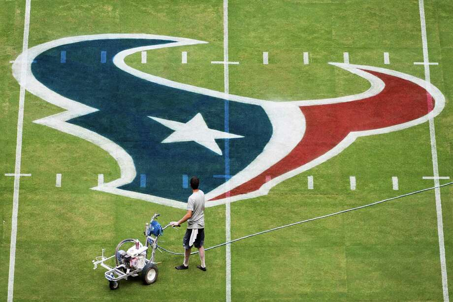 THE BEST: Some Texans fans in Houston don't like the bull silhouette logo that mimics the Texas state flag, but it probably keeps a cartoonish Davy Crockett off the side of the Texans' helmets. Photo: Smiley N. Pool, Houston Chronicle / © 2013  Houston Chronicle