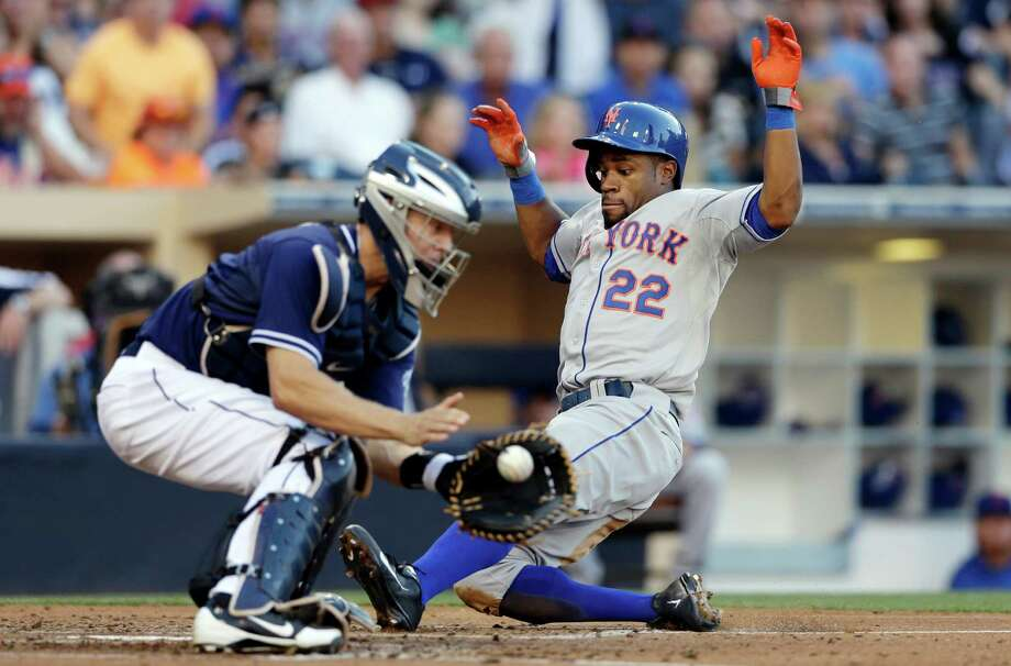 New York Mets' Eric Young Jr., right, slides in safely into home to score as San Diego Padres catcher Nick Hundley, left, waits for the ball during the third inning in a baseball game on Saturday, Aug. 17, 2013, in San Diego. (AP Photo/Gregory Bull) ORG XMIT: CAGB111 Photo: Gregory Bull / AP
