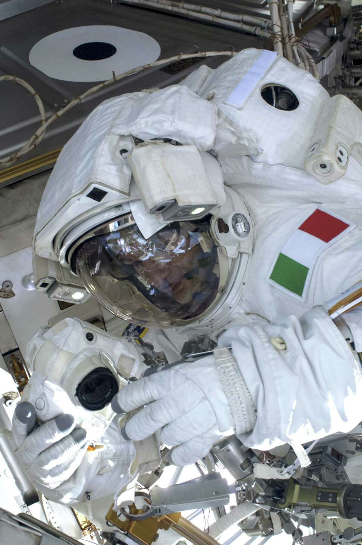 European Space Agency astronaut Luca Parmitano, Expedition 36 flight engineer, participates in a spacewalk at the International Space Station in July. Fresh jockeying on Capitol Hill over NASA's destination and spending is complicating planning for NASA's future.