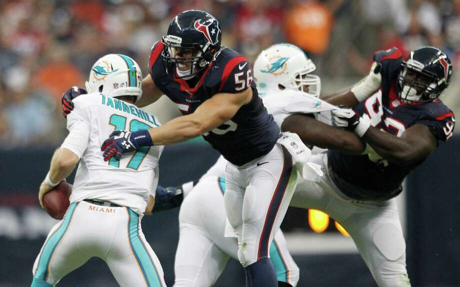 Linebacker Brian Cushing, right, trying to wrap up Dolphins QB Ryan Tannehill, took part in 10 plays and made one tackle. Photo: Brett Coomer, Staff / © 2013  Houston Chronicle