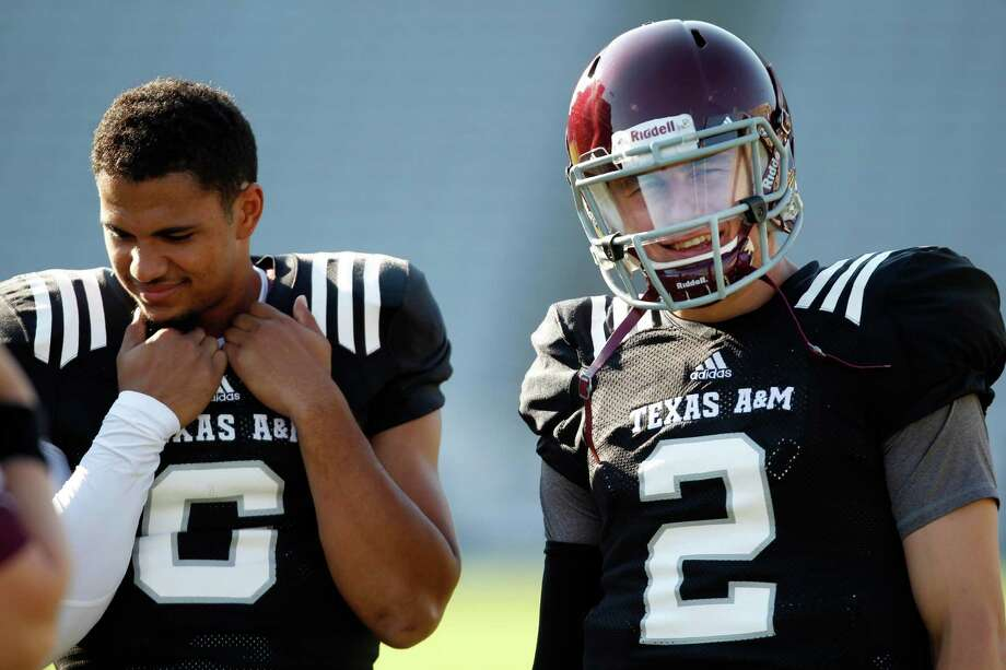 Texas A&M quarterbacks Johnny Manziel, right, and Matt Davis before an intersquad scrimmage game, Saturday, August 17, 2013 at Kyle Field in College Station, TX. Photo: Eric Christian Smith, For The Chronicle