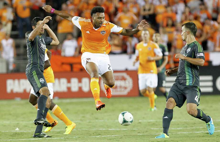 8/17/13: Houston Dynamo midfielder Giles Barnes (23) splits the Seattle Sounders FC defense in the second half at BBVA Compass Stadium in Houston, Texas. Dynamo won 3 to 1. Photo: Thomas B. Shea, For The Chronicle / © 2013 Thomas B. Shea