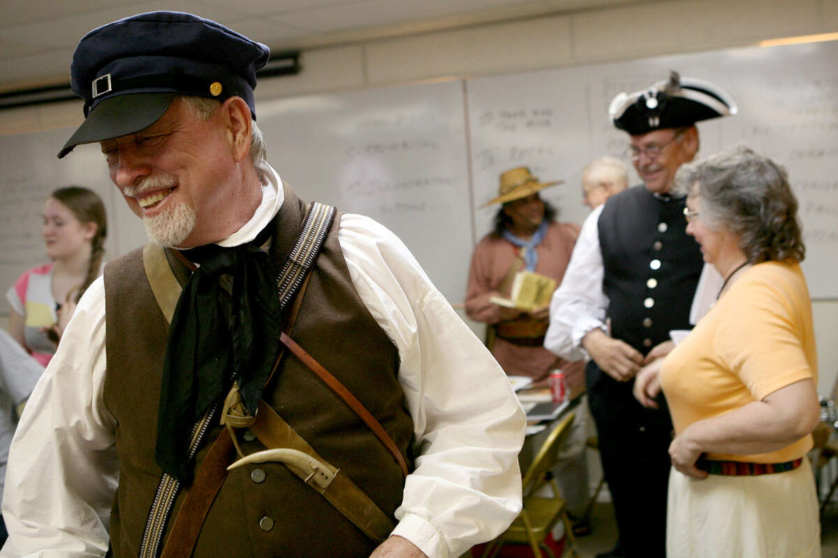 Carl Hill, sporting an outfit patterned after those worn around 1812, takes a break during a seminar at the Church of Christ in Pleasanton during the observance of the 200th anniversary of the Battle of Medina, which is ranked as the bloodiest battle in Texas history.
