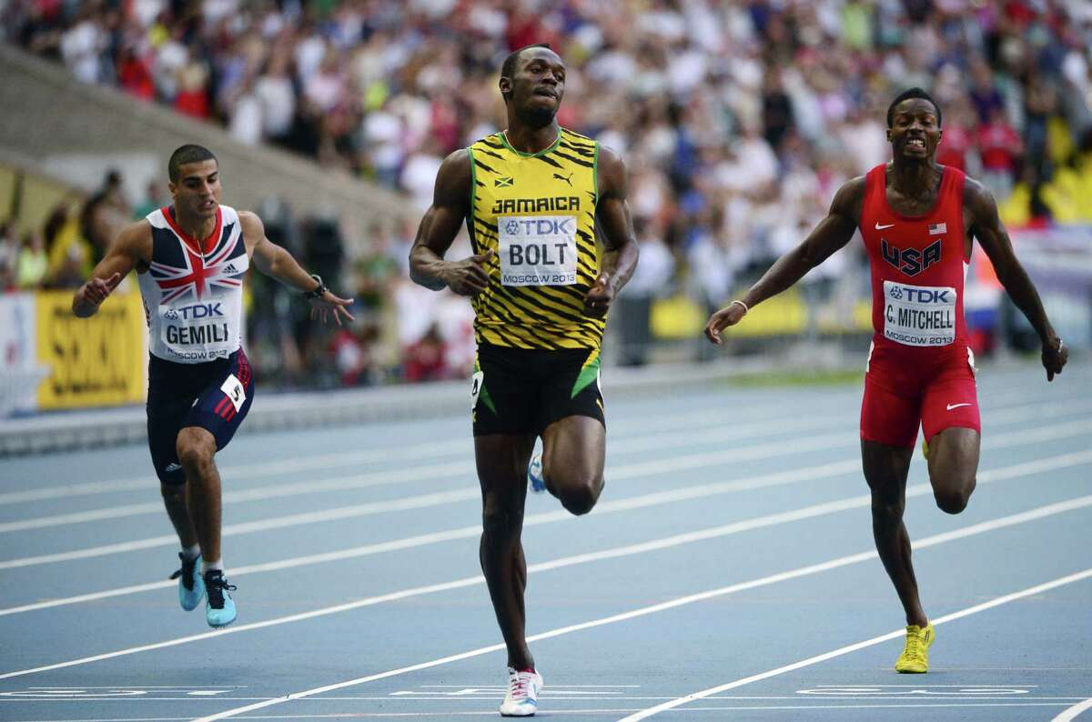 Jamaica's Usain Bolt (center) wraps up his third straight 200-meter title at the world championships in Moscow. A&M product Curtis Mitchell (right) of the U.S. came in third.