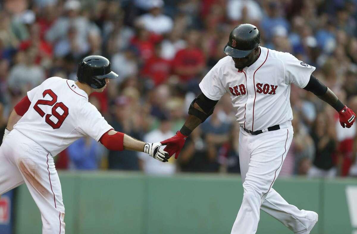 Boston's David Ortiz (right) celebrates a solo home run with Daniel Nava in the seventh inning.