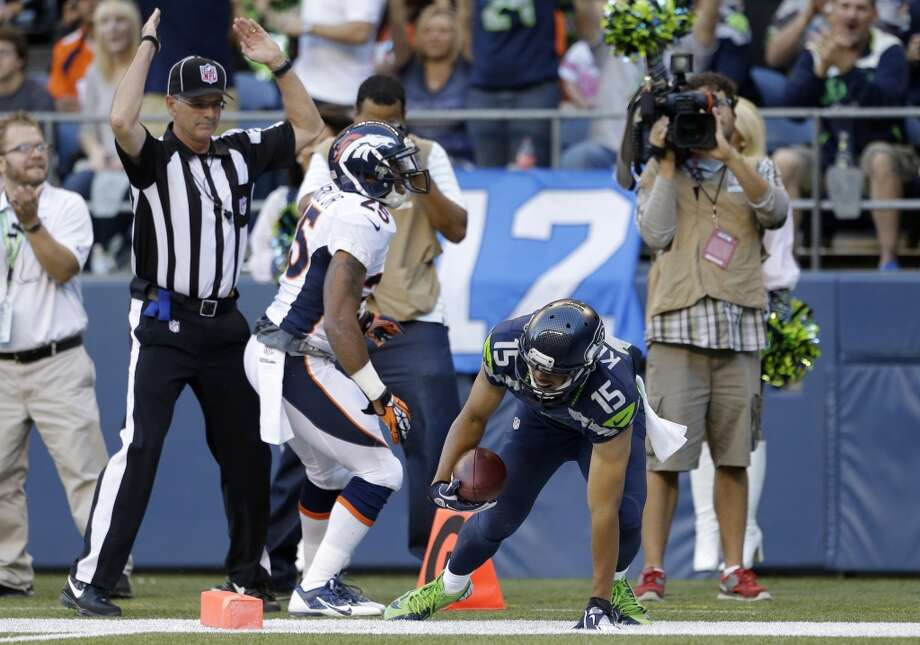 Seattle Seahawks' Jermaine Kearse (15) gets up after scoring a touchdown against Denver Broncos' Chris Harris (25) in the first half of a preseason NFL football game, Saturday, Aug. 17, 2013, in Seattle. (AP Photo/Elaine Thompson) Photo: ASSOCIATED PRESS