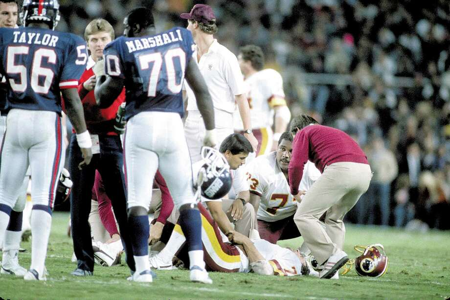 Redskins quarterback Joe Theismann's career came to an infamous end in 1985 with a severely broken leg on MNF. Photo: George Gojkovich / Getty Images