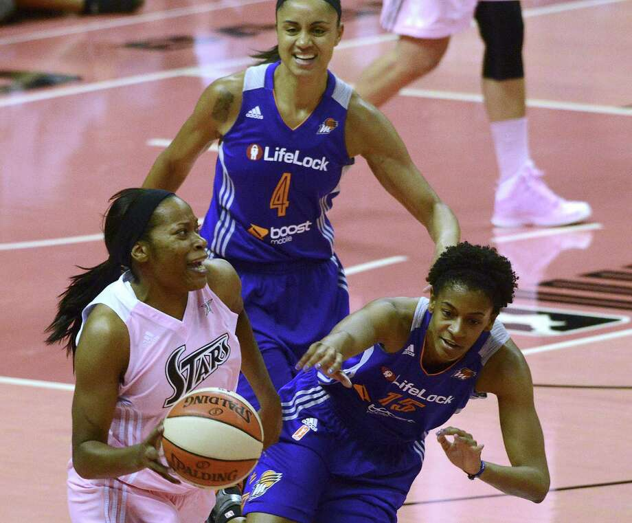 Jia Perkins (left), trying to dribble past the Mercury's Briana Gilbreath (right) and Candice Dupree, had 17 points as part of a balanced Silver Stars' attack Saturday night. Photo: Billy Calzada / San Antonio Express-News