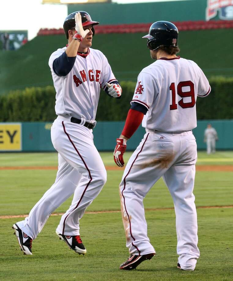 Aug. 17: Angels 6, Astros 5 (10)  Mike Trout and Collin Cowgill of the Angels of Anaheim celebrate after both score on Mark Trumbo's two run triple. Photo: Stephen Dunn, Getty Images