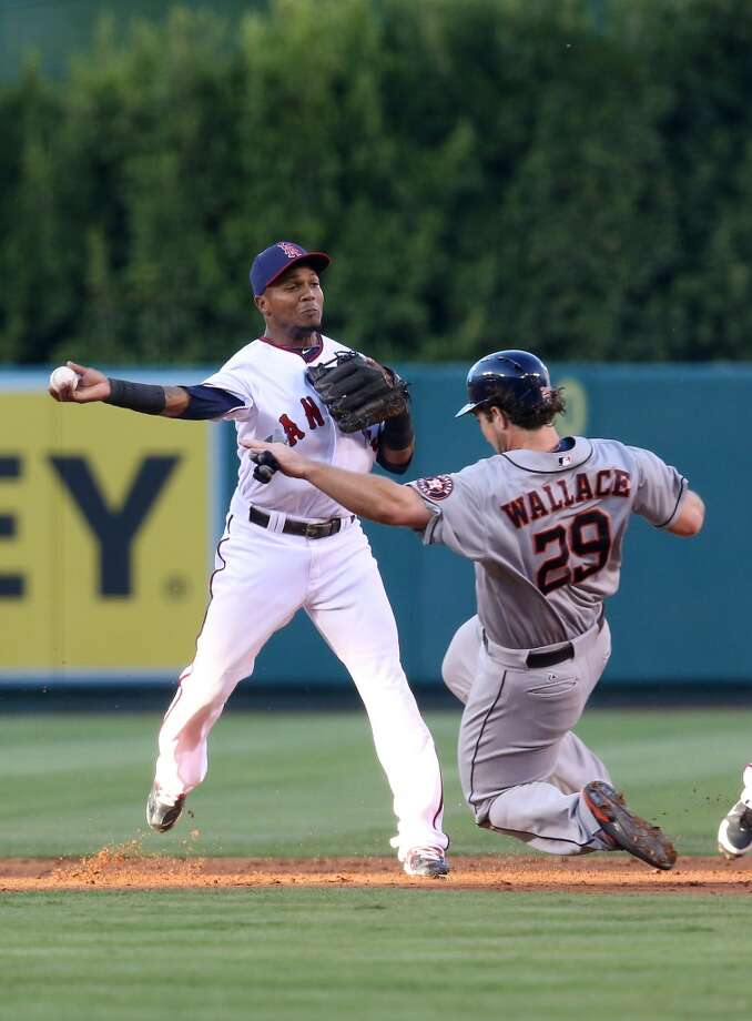 Shortstop Erick Aybar of the Angels throws to first to complete a double play. Photo: Stephen Dunn, Getty Images