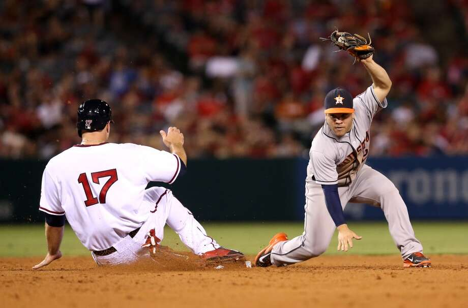 Second baseman Jose Altuve holds up the ball after fielding a wide throw. Photo: Stephen Dunn, Getty Images
