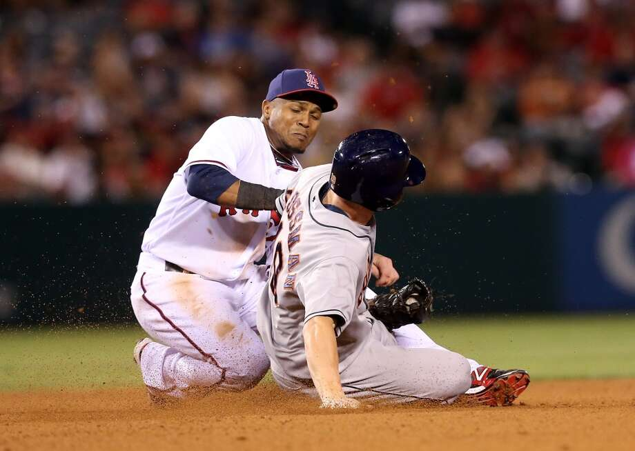 Shortstop Erick Aybar of the Angels tags out Robbie Grossman. Photo: Stephen Dunn, Getty Images
