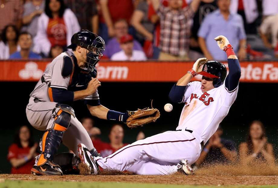 Mike Trout of the Angels slides home with the tying run. Photo: Stephen Dunn, Getty Images