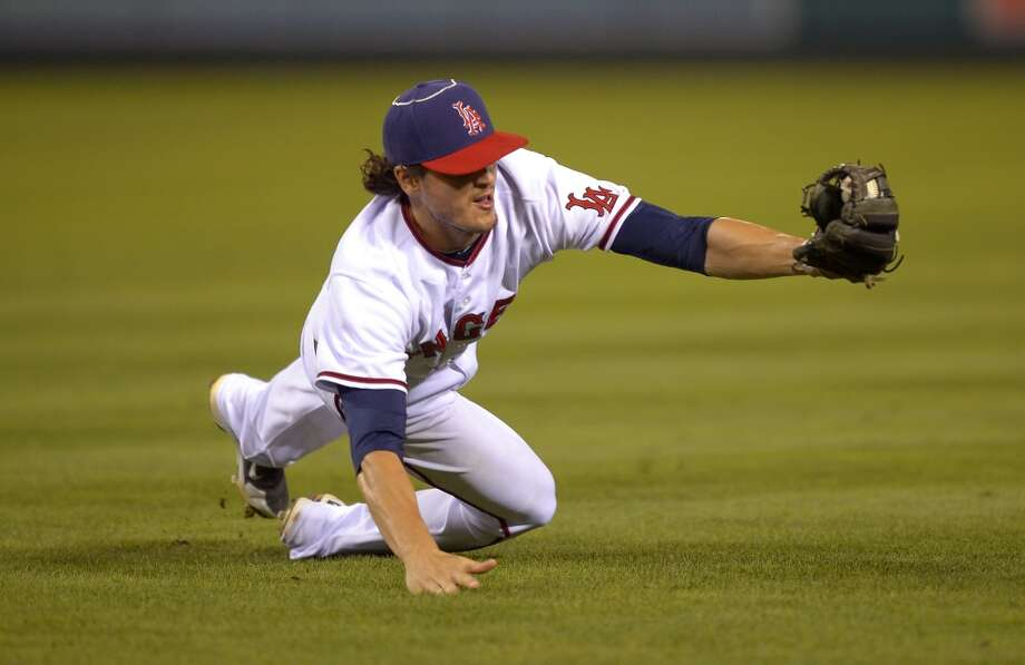 Angels second baseman Grant Green stops a grounder by L.J. Hoes. Photo: Mark J. Terrill, Associated Press