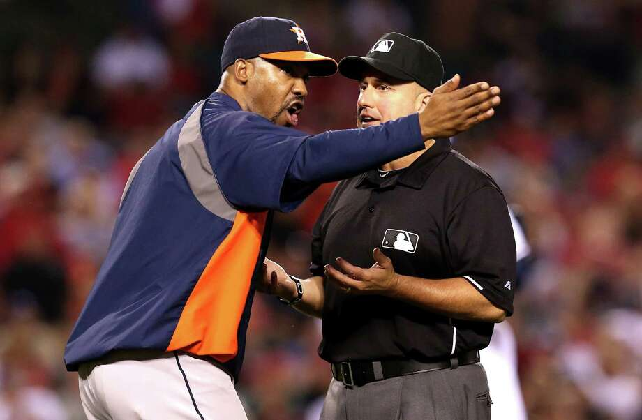 Astros manager Bo Porter argues in vain in the ninth inning after the umpires reversed a safe call on L.J. Hoes, who was trying to stretch a single into a double. Photo: Stephen Dunn, Staff / 2013 Getty Images
