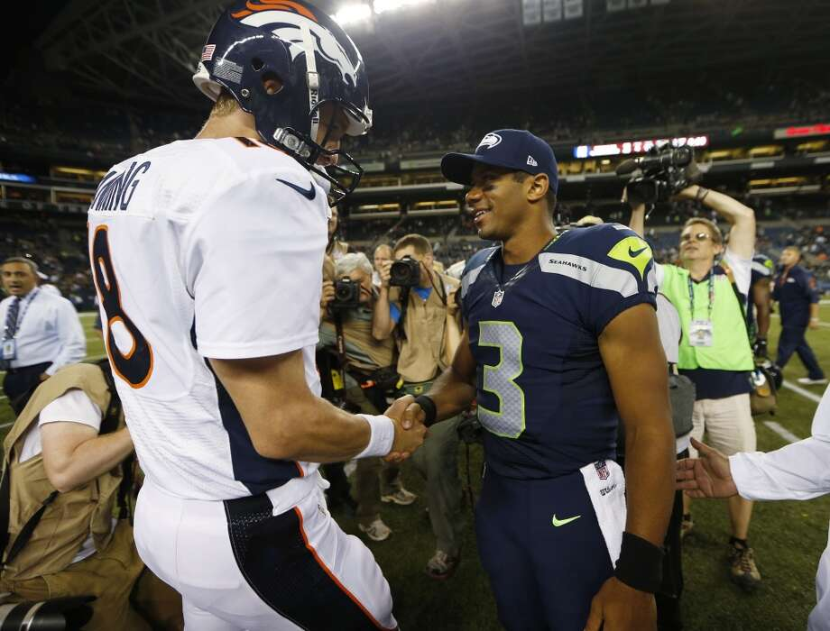 Seattle Seahawks quarterback Russell Wilson (3) shakes hands with Denver Broncos quarterback Peyton Manning, left, after the Seahawks beat the Broncos 40-10, in preseason NFL football game, Saturday, Aug. 17, 2013, in Seattle. (AP Photo/John Froschauer) Photo: AP