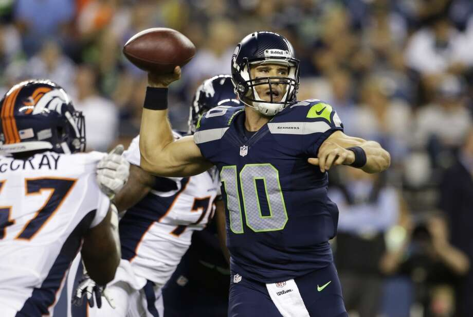 Seattle Seahawks backup quarterback Brady Quinn passes against the Denver Broncos in the second half of a preseason NFL football game, Saturday, Aug. 17, 2013, in Seattle. (AP Photo/Elaine Thompson) Photo: AP