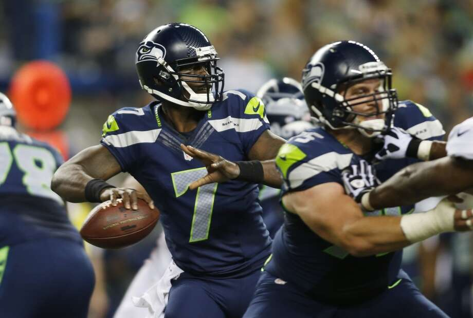 Seattle Seahawks backup quarterback Tarvaris Jackson (7) looks to pass in the second half of a preseason NFL football game against the Denver Broncos, Saturday, Aug. 17, 2013, in Seattle. (AP Photo/John Froschauer) Photo: AP