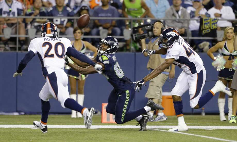 Seattle Seahawks wide receiver Stephen Williams center, catches a pass for a touchdown in between the defense of Denver Broncos' Mike Adams (20) and Aaron Hester (40) in the second half of a preseason NFL football game, Saturday, Aug. 17, 2013, in Seattle. (AP Photo/Elaine Thompson) Photo: ASSOCIATED PRESS