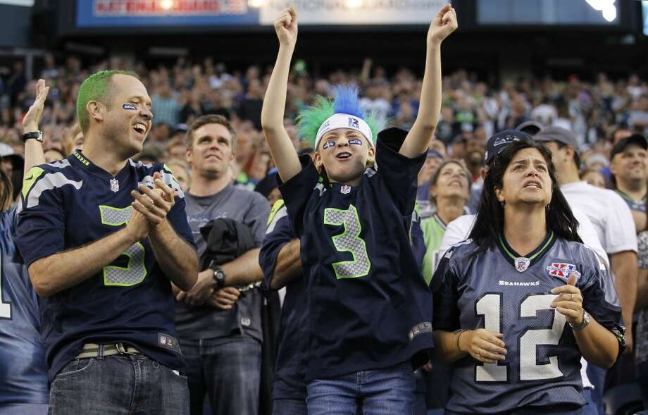 Seattle Seahawks fans cheer during the first half of a preseason NFL football game against the Denver Broncos, Saturday, Aug. 17, 2013, in Seattle. (AP Photo/John Froschauer) Photo: AP