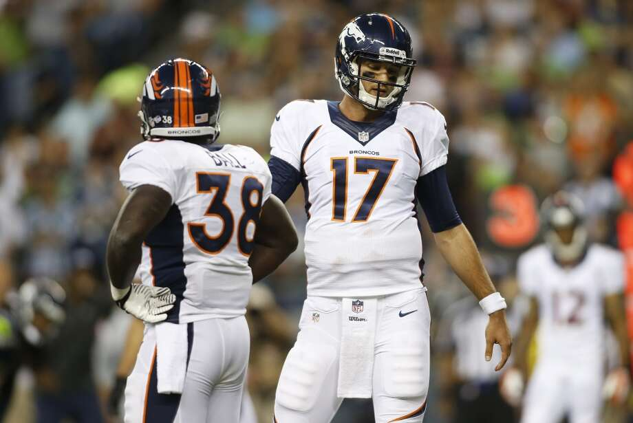 Denver Broncos backup quarterback Brock Osweiler (17) and running back Montee Ball (38) react to a play against the Seattle Seahawks in the first half of a preseason NFL football game, Saturday, Aug. 17, 2013, in Seattle. (AP Photo/John Froschauer) Photo: AP