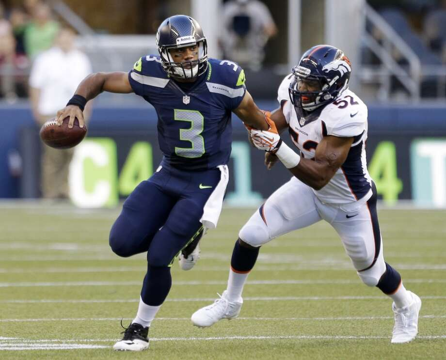 Seattle Seahawks quarterback Russell Wilson (3) scrambles while being chased by Denver Broncos' Wesley Woodyard in the first half of a preseason NFL football game, Saturday, Aug. 17, 2013, in Seattle. (AP Photo/Elaine Thompson) Photo: ASSOCIATED PRESS
