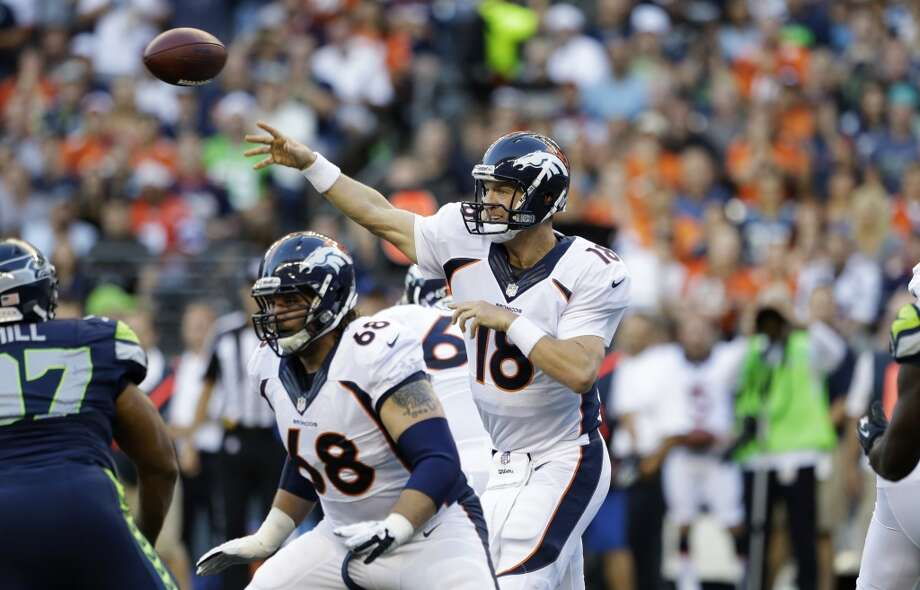 Denver Broncos quarterback Peyton Manning (18) passes as Zane Beadles (68) blocks in the first half of a preseason NFL football game against the Seattle Seahawks, Saturday, Aug. 17, 2013, in Seattle. (AP Photo/Elaine Thompson) Photo: ASSOCIATED PRESS