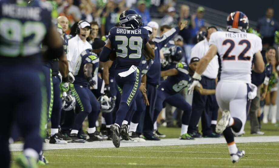 Seattle Seahawks' Brandon Browner (39) runs for a 106-yard touchdown after recovering a fumble as Denver Broncos' Jacob Hester (22) looks on in the first half of a preseason NFL football game, Saturday, Aug. 17, 2013, in Seattle. (AP Photo/Elaine Thompson) Photo: AP