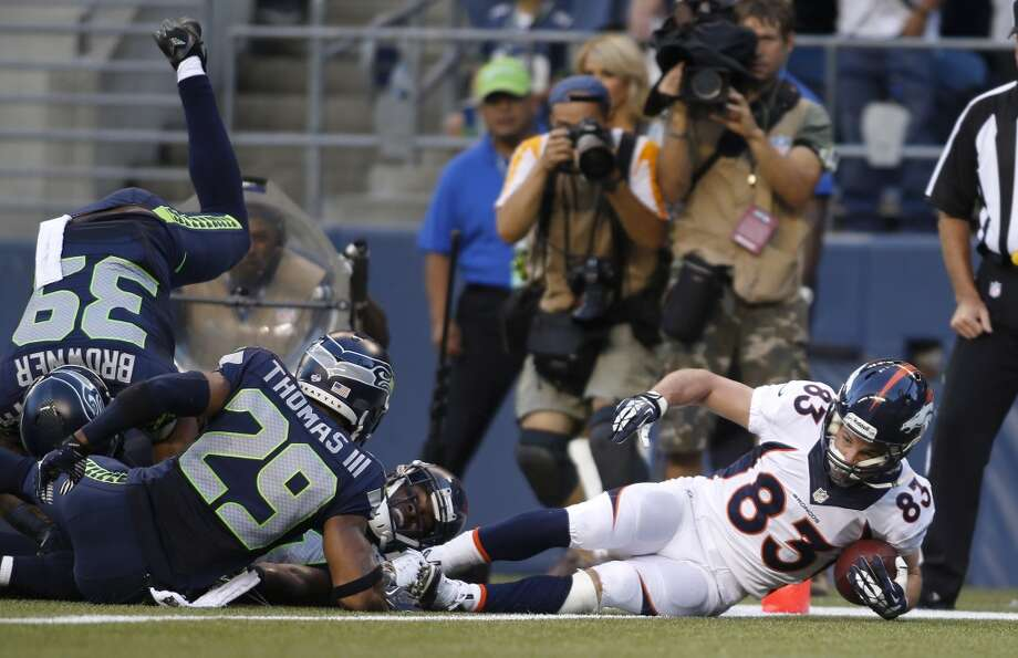 Denver Broncos' Wes Welker (83) scores a touchdown in the first half of a preseason NFL football game against the Seattle Seahawks, Saturday, Aug. 17, 2013, in Seattle. (AP Photo/John Froschauer) Photo: ASSOCIATED PRESS