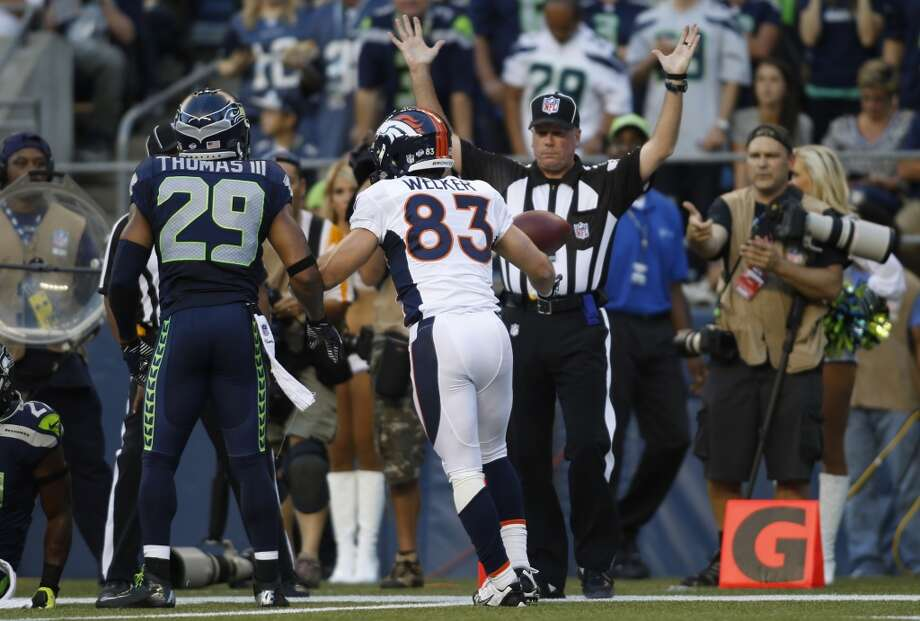 Denver Broncos' Wes Welker (83) gets up after he scored a touchdown in the first half of a preseason NFL football game against the Seattle Seahawks, Saturday, Aug. 17, 2013, in Seattle. (AP Photo/John Froschauer) Photo: ASSOCIATED PRESS