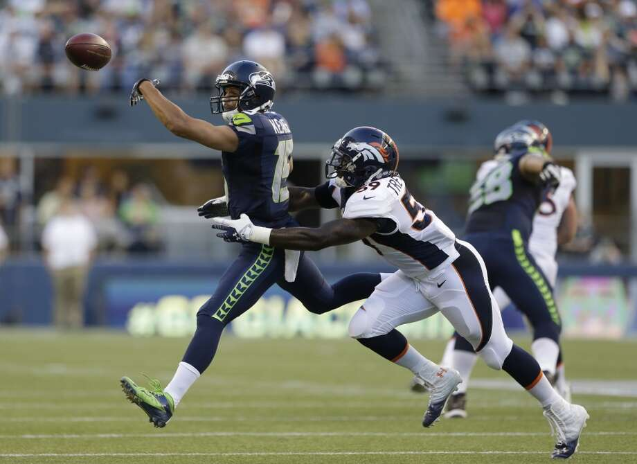 Seattle Seahawks' Jermaine Kearse, left, reaches for a pass just out of reach as Denver Broncos' Danny Trevathan defends in the first half of a preseason NFL football game, Saturday, Aug. 17, 2013, in Seattle. (AP Photo/Elaine Thompson) Photo: ASSOCIATED PRESS