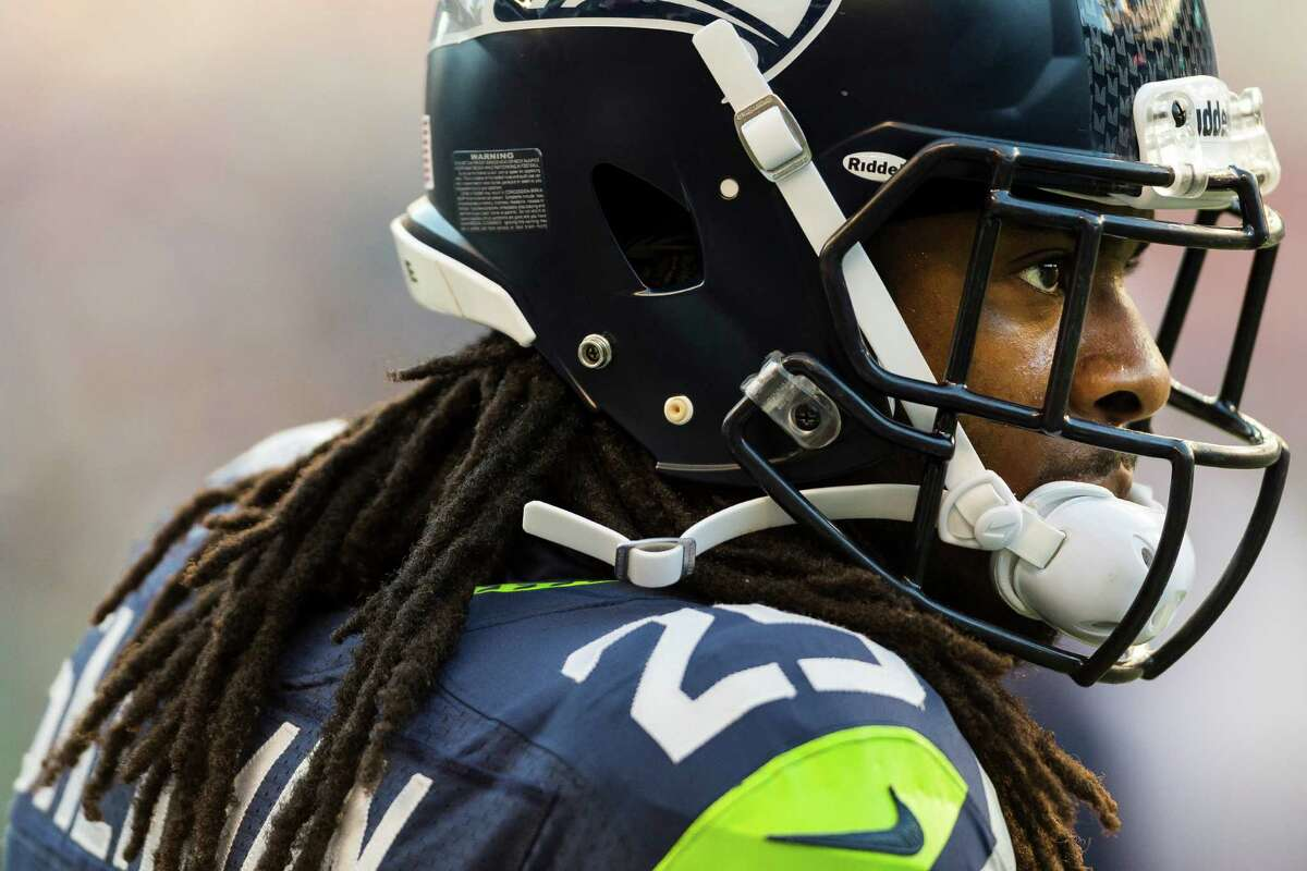 Richard Sherman warms up before the first half of a preseason game Saturday, August 17, 2013, at CenturyLink Field in Seattle. The event marked the Seahawks first home game this season.