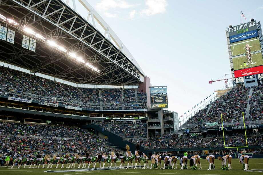 The Sea Gals perform for thousands before the first half of a preseason game Saturday, August 17, 2013, at CenturyLink Field in Seattle. The event marked the Seahawks first home game this season. Photo: JORDAN STEAD, SEATTLEPI.COM / SEATTLEPI.COM
