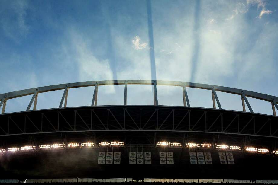 Evening light streams through smoke created from fireworks before the first half of a preseason Seahawks game Saturday, August 17, 2013, at CenturyLink Field in Seattle. The event marked the Seahawks first home game this season. Photo: JORDAN STEAD, SEATTLEPI.COM / SEATTLEPI.COM