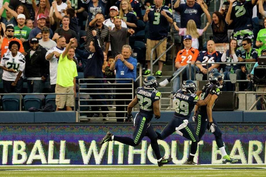 Jermaine Kearse, right, is congratulated by teammates after scoring the second touchdown of a preseason game against the Denver Broncos Saturday, August 17, 2013, at CenturyLink Field in Seattle. The event marked the Seahawks first home game this season. Photo: JORDAN STEAD, SEATTLEPI.COM / SEATTLEPI.COM
