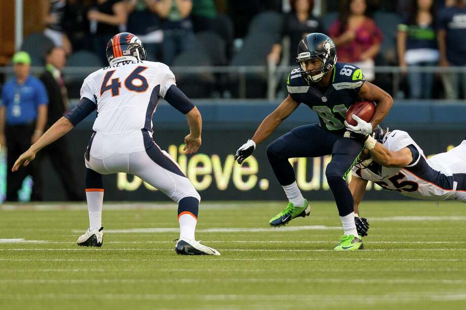 Golden Tate evades being tackled during the first half of a preseason game Saturday, August 17, 2013, at CenturyLink Field in Seattle. The event marked the Seahawks first home game this season. Photo: JORDAN STEAD, SEATTLEPI.COM / SEATTLEPI.COM