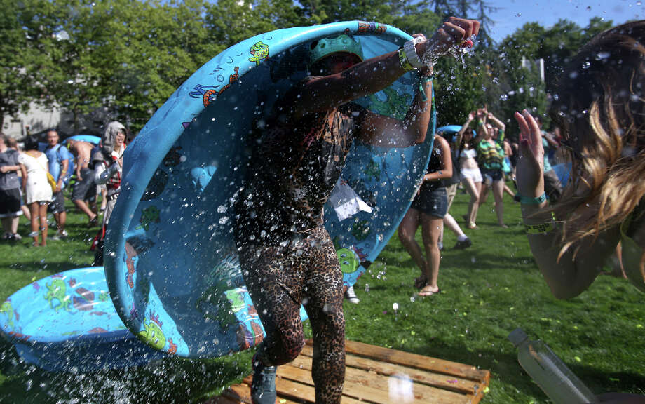 A water balloon is squeezed during an attempt to set a Guinness World Record for the largest water balloon fight. Photo: JOSHUA TRUJILLO, SEATTLEPI.COM / SEATTLEPI.COM