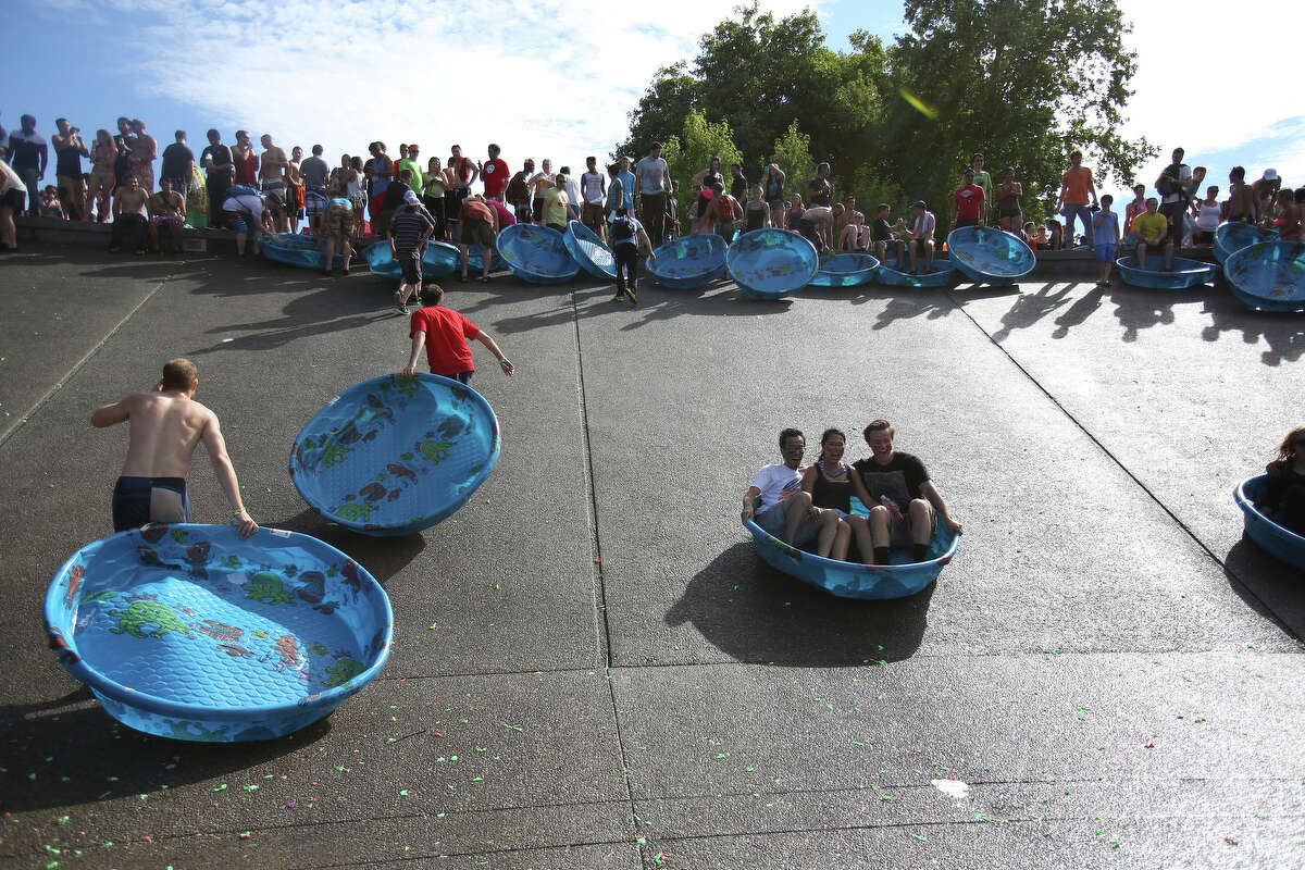 Kiddie pools used to hold water balloons are used to slide down the sloped walls of the International Fountain during an attempt to set a Guinness World Record for the largest water balloon fight. The record was not broken but it was discovered that the plastic pools make excellent sleds.