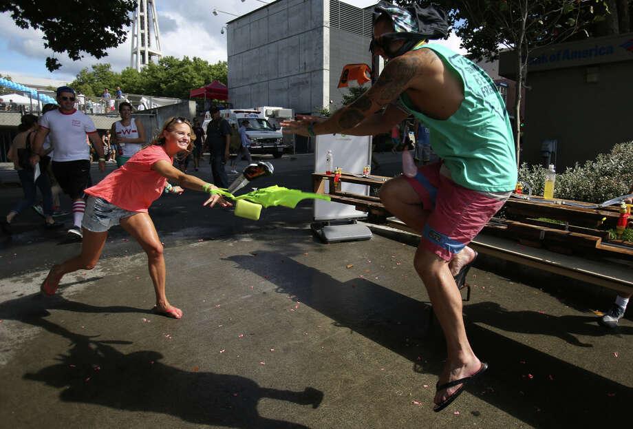 A participant tries to avoid a balloon thrown at him. Photo: JOSHUA TRUJILLO, SEATTLEPI.COM / SEATTLEPI.COM