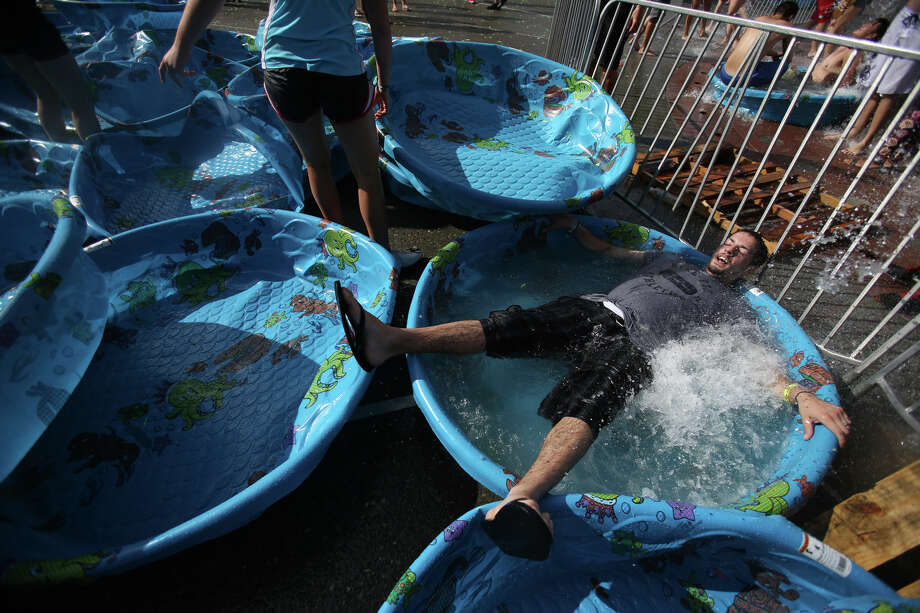A participant cools off in water during an attempt to set a Guinness World Record for the largest water balloon fight. Photo: JOSHUA TRUJILLO, SEATTLEPI.COM / SEATTLEPI.COM
