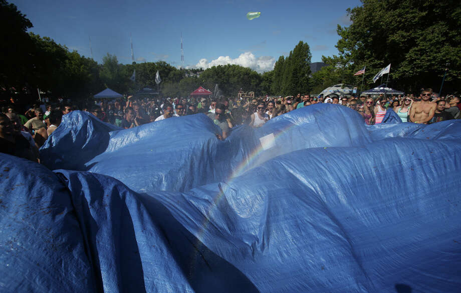 A single balloon flies through the air, launched from a tarp during an attempt to set a Guinness World Record for the largest water balloon fight.  Photo: JOSHUA TRUJILLO, SEATTLEPI.COM / SEATTLEPI.COM