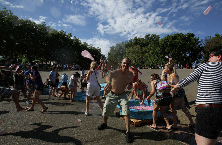A balloon is thrown during an attempt to set a Guinness World Record for the largest water balloon fight. Photo: JOSHUA TRUJILLO, SEATTLEPI.COM / SEATTLEPI.COM