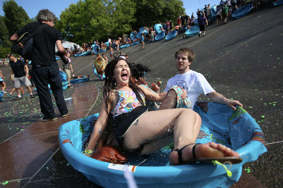 People sliding in a pool hit a bump. Photo: JOSHUA TRUJILLO, SEATTLEPI.COM / SEATTLEPI.COM
