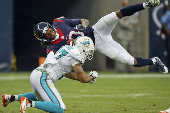 DeAndre Hopkins is hit by Miami's Jimmy Wilson during first half action.